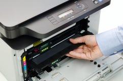 Man replacing toner in laser printer Royalty Free Stock Photo