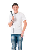 Man reporter holding a microphone. Young man reporter holding a microphone, isolated on white background Stock Photo