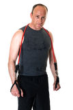 Man With Resistance Band. Adult man with a resistance band. Studio shot over white Royalty Free Stock Photo