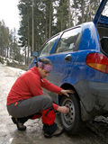 Man resolving a tyre puncture. Man changing the wheel after a tyre puncture Stock Photography