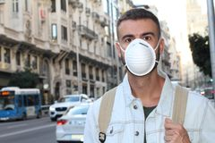 Man with respiratory system problems in polluted environment.  Royalty Free Stock Image