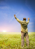 Man rest on green field Royalty Free Stock Images
