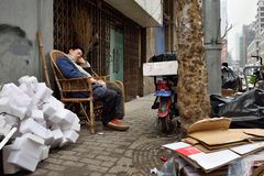 Man rest in a street, China Royalty Free Stock Image