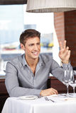 Man in restaurant calling Royalty Free Stock Photography