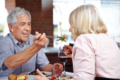 Man in restaurant letting woman Stock Photo
