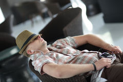 Man resting in armchair Royalty Free Stock Images