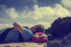 Man resting on beach royalty free stock images