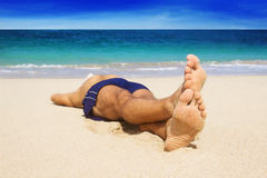 Man resting on the beach Stock Images