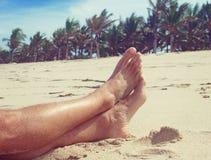 Man resting on the beach Royalty Free Stock Photos
