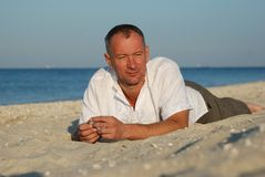 Man resting on the beach Royalty Free Stock Image