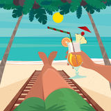 Man resting on the beach. Man lying on a sun lounger by the sea and holding in his hand an exotic cocktail - Beach holidays concept Royalty Free Stock Photo