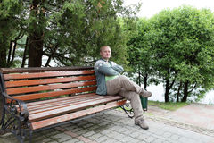 Man resting on bench Royalty Free Stock Photography
