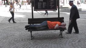 Man resting on a bench stock video footage