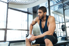 Man resting on the bench in the gym Stock Photos