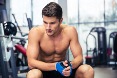 Man resting on the bench at gym Stock Photography