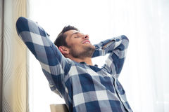 Man resting on the chair at home Royalty Free Stock Photo