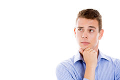 Man resting chin on hand, brows raised and daydreaming, staring thoughtfully upwards Stock Images