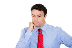 Man resting chin on hand, daydreaming and thinking deeply Stock Photography