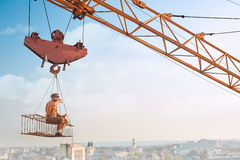 Man resting on construction on high and eating. Royalty Free Stock Images
