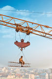 Man resting on construction on high and eating. Royalty Free Stock Photography