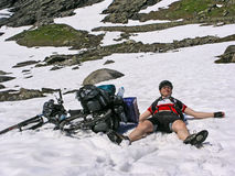 Man resting after cycling ascent Stock Photos