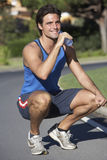 Man Resting And Drinking Water After Exercise Stock Photography