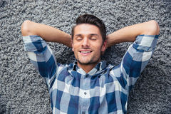 Man resting on the floor at home Royalty Free Stock Photos