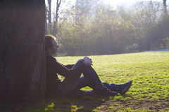 Man resting on the green grass Stock Photo