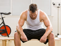 Man resting in health club Stock Images