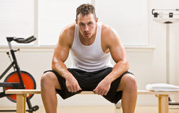 Man resting in health club Stock Image