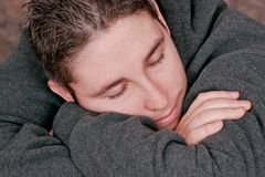 Man resting on his arms Royalty Free Stock Photography