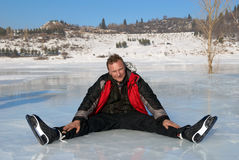 Man resting on ice after riding Royalty Free Stock Photo
