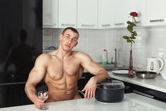 Man resting in the kitchen. Stock Image