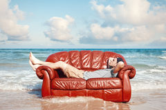 Man resting in leather couch Royalty Free Stock Photo