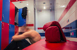Man resting in locker room after training Royalty Free Stock Photos