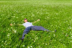 Man resting lying on the grass Stock Photography