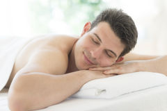 Man Resting On Massage Table At Health Spa Royalty Free Stock Photo