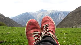 A man resting in mountains Royalty Free Stock Images