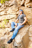 Man resting in the mountains Stock Photography