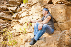 Man resting in the mountains Royalty Free Stock Image
