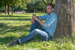 Man resting in nature with a cup of coffee Stock Photos