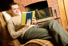 Man resting near fireplace Royalty Free Stock Photography