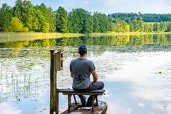 Man resting near lake Stock Photography