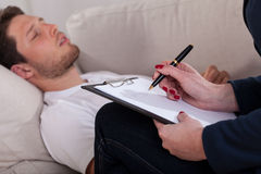 Man resting at psychotherapist room Stock Images