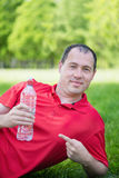 Man resting after recreation on the green grass Stock Photo