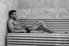 Man Resting Relaxed In The Hot Sauna Stock Images