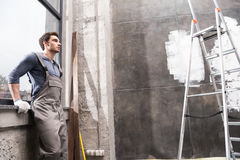 Man resting while renovating home, renovation home concept Stock Images