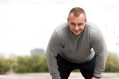 Man resting after run. Outdoor jogger. Stock Photos