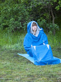 The man is resting in a sleeping bag. Stock Photos