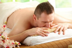 Man resting in spa salon royalty free stock images